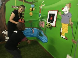 mural wall art assists first swing golf program helping children with disabilities social event